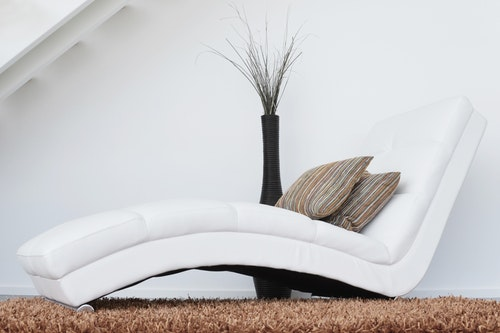image of carpet in a living room with a lounging chair